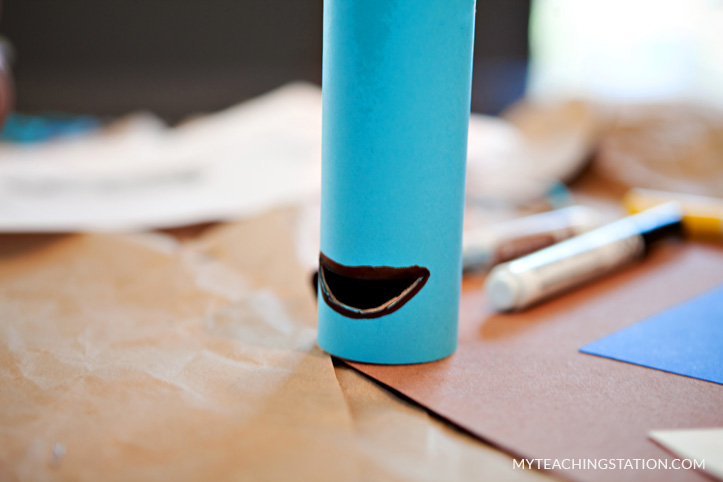 Use a marker to draw a line around the mouth opening in the toilet paper roll.