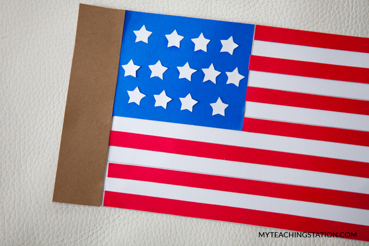 Attach extra paper on the side of the flag in order to hold it onto the pole.